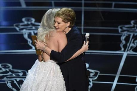 Julie Andrews (right) hugged Lady Gaga after gaga's performance.