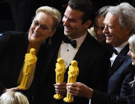 Meryl Streep (left), Bradley Cooper, and Clint Eastwood  posed with Oscars made of lego bricks after the end of the 87th Academy Awards.