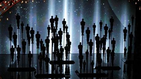 Oscar statues on stage.