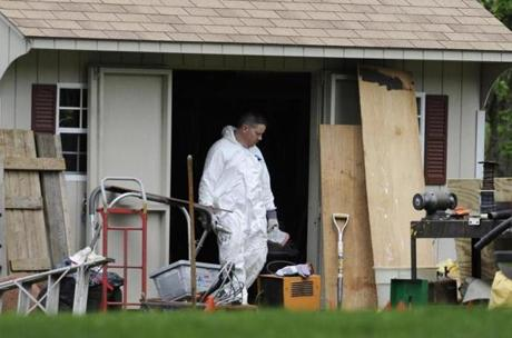 A law enforcement agent searched a shed behind the home of reputed Connecticut mobster Robert Gentile in Manchester, Conn.