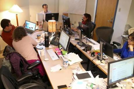 In their basement office at Boston University, journalists work on the start-up US edition of The Conversation, a scholarly contribution to the news cycle.