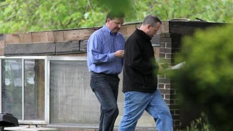 Manchester CT. -05/10/2012 A FBI Evidence Response Team at the home of Robert Gentile (cq) who may be a suspect in the Gardner Museum heist . Anthony Amore, (left) the security director of the Gardner Museum in the blue shirt, and Brian Kelly, the now-retired assistant US attorney who over saw the FBI investigation for the US attorney's office, in jeans and black pullover.Staff / Photographer: Jonathan Wiggs Reporter:Section:Metro :Reporter:Slug