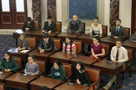 BOSTON, MA - 3/06/2015: Students from Quincy and North Quincy sit in a Senate mockup at The Ted Kennedy Institute (David L Ryan/Globe Staff Photo) SECTION: MAGAZINE TOPIC 0329SenatePhoto(2)