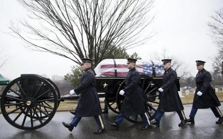 Army honor guards marched alongside the caisson carrying Brooke's coffin.