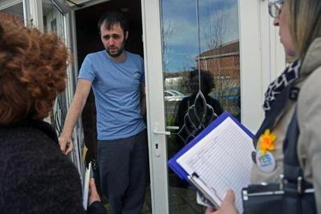 """Yes"" campaign volunteers are going door to door to win the support of the undecided and persuade voters to go to the polls on May 22 to cast ballots in favor of legalizing same-sex marriage."