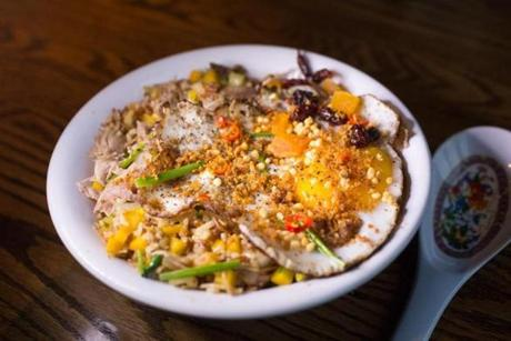 March 26, 2015 - Blue Dragon Duck Confit Fried Rice with Pumpkin Mirepoix and Crispy XO Duck Egg. (Katherine Taylor for The Boston Globe)