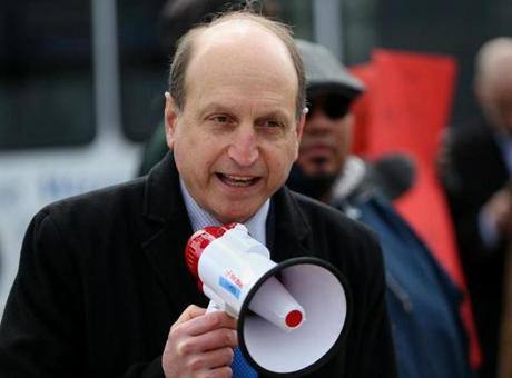 Boston 04/02/2015 Massachusetts State Senator Daniel A. Wolf (cq) middle in blue tie, was part of a group protesting for higher wages. They were protesting near a McDonald's Restaurant on Massachusetts Avenue. Staff/Photographer Jonathan Wiggs Topic: Reporter