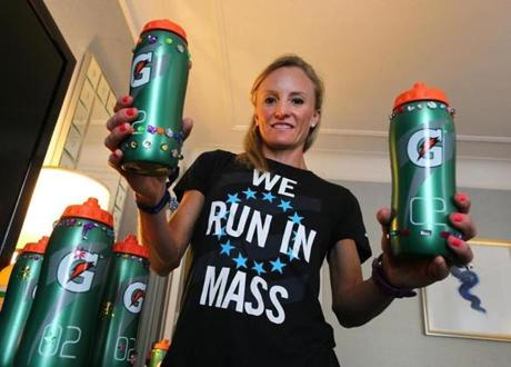 Boston-04/18/15- Elite Boston Marathon runners mark their drinking bottles in unique ways before they race, as the bottles are left off at the several stations along the way where they pick them up and drink from them. Runner Shalane Flanagan puts dazzles on her bottles. They have to be marked and filled and turned in to race officials by Sunday. Boston Globe staff photo by John Tlumacki (metro)