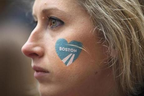 4/20/2015 - Boston, MA - Brittany Busa, cq, of Charlestown, cq, sported a BAA heart on her face. She was on Boylston Street to cheer on her sister, who is running the race. Boylston Street - Spectators lined the Boylston Street in Boston, near the finish of the 119th Boston Marathon on Monday, April 20, 2015. Topic: Race coverage. Photo by Dina Rudick/Globe Staff.