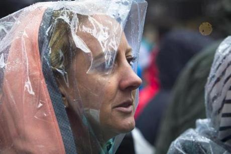 4/20/2015 - Boston, MA - Boylston Street - Soaked spectators lined a rainy, cold Boylston Street in Boston, near the finish of the 119th Boston Marathon on Monday, April 20, 2015. Topic: Race coverage. Photo by Dina Rudick/Globe Staff.