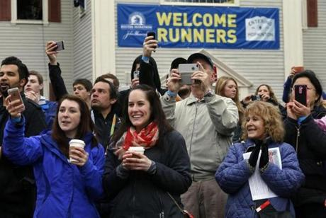 Hopkinton, MA - 4-20-15 - Boston Marathon - Spectators cheer the mobility impaired division as they leave the start of the Boston Marathon in Hopkinton, MA. (Globe staff / Bill Greene)