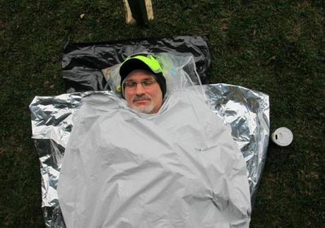 Hopkinton, MA - 04/20/15 - Rich Vaillant of Shrewsbury gets a nap in under the tent in the Athlete's Village at the start in Hopkinton before the 2015 Boston Marathon. Lane Turner/Globe Staff Section: SPORTS Reporter: various Slug: race coverage