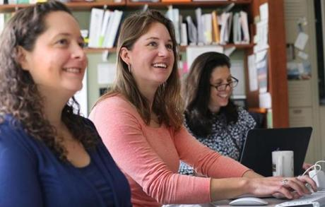 From left, Heather Carroll, Kathryn Evans, and Nancy Cibotti-Granof, who work at Iora Primary Care in Burlington, took part inadaily staff meeting Friday morning.