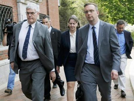 Defense attorneys Judy Clarke, center, and Tim Watkins, left, walked out of the courthouse.