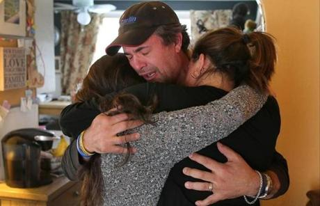 The Corcoran family reacted after hearing that the jury sentenced Tsarnaev to death. Kevin Corcoran cried as he hugged his daughter, Sydney (left) and his wife, Celeste, who were both injured in the bombing.
