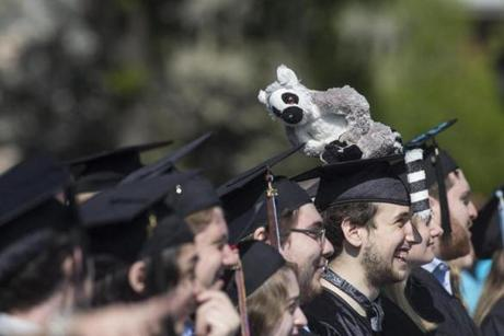 Anschel Schaffer-Cohen wore a smile and a stuffed lemur on his cap during commencement for Tufts University's class of 2015 in Medford Sunday.