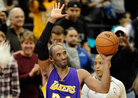 MINNEAPOLIS, MN - DECEMBER 14: Kobe Bryant #24 of the Los Angeles Lakers waves to the crowd after passing Michael Jordan on the all-time scoring list with a free throw in the second quarter of the game on December 14, 2014 at Target Center in Minneapolis, Minnesota. NOTE TO USER: User expressly acknowledges and agrees that, by downloading and or using this Photograph, user is consenting to the terms and conditions of the Getty Images License Agreement. (Photo by Hannah Foslien/Getty Images)