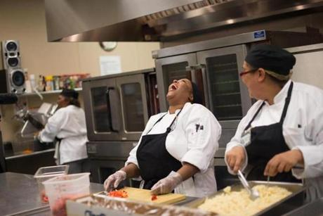 Marie Jean-Gilles laughed with others while they prepared food.