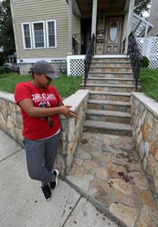 Lizanna Guzman noted blood on the steps to her house in Hyde Park.