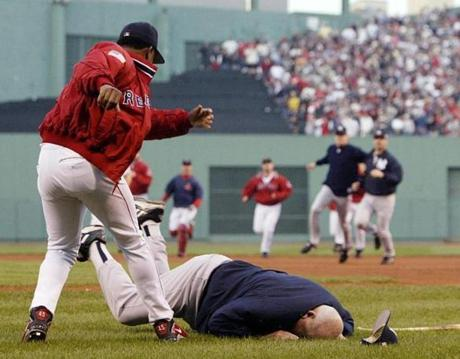 Pedro Martinez, left, threw New York Yankees bench coach Don Zimmer to the ground after Clemens threw a high ball to Manny Ramirez in the fourth inning of Game 3 of the ALCS, Oct. 11, 2003.