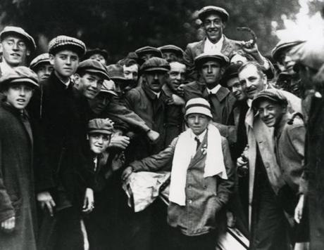 Sept. 20, 1913: Francis Ouimet, 20, with lucky horseshoe in hand, got lifted up by fans after winning the 1913 US Open playoff. His caddie, Eddie Lowry, just 10 years old, sat in front with a towel draped over his neck. Ouimet, the first amateur ever to win the US Open, beat British professionals Harry Vardon by five shots and Ted Ray by six shots. He did this using just seven clubs in his bag. Ouimet, who went on to win several US Amateur Championships and played in the Walker Cup, never turned professional. He was inducted into the World Golf Hall of Fame in 1974.