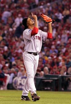 Boston Red Sox pitcher Pedro Martinez pointed to the sky as he left the field after the seventh inning of the third game of the World Series against the St. Louis Cardinals at Busch Stadium on Oct. 26, 2004.