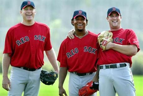 The Red Sox were expected to have one of the most feared top three starting pitchers at the top of their rotation in all of baseball the 2004 season. Curt Schilling (left) and Derek Lowe (right) had been in camp for some time, but they were happy to see the third member of the troika, Pedro Martinez (center) arrive for his first spring training workout Feb. 24, 2004.