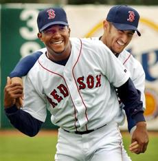 Red Sox stars Pedro Martinez (left), and Nomar Garciaparra have some fun with each other in the outfield at City of Palms Park during an afternoon spring training workout on March 1, 2002.