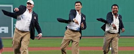 Roger Clemens, Nomar Garciaparra and Pedro Martinez threw out ceremonial first pitches as their Red Sox Hall of Fame blazers flapped in the wind. They were inducted into the team's hall of fame along with longtime radio voice Joe Castiglione in an on-field ceremony on Aug. 14, 2014.