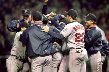 Red Sox players celebrate around Pedro Martinez after winning Game 5 against the Cleveland Indians advance to the ALCS against the New York Yankees.