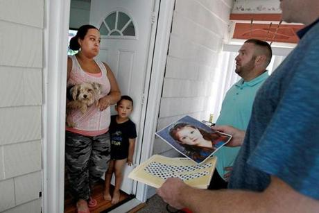 Winthrop Detectives Timothy Callinan (far right) and Wayne Carter followed up on a Baby Doe tip with Andrea Mesa and her son Anthony.