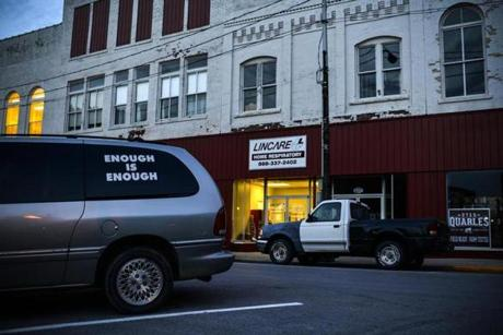 "A van with the words ""Enough is Enough,"" the slogan of an antidrug program, was parked in downtown Pineville."