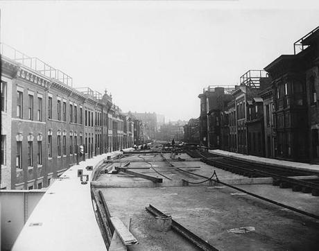During construction of the West End's elevated railway in September 1911 along what was then called Lowell Street, No. 42 was on the left, about midway down to Causeway Street, in this archival view.