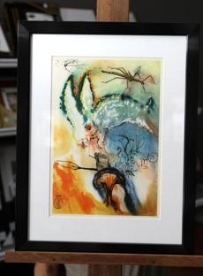 "A framed page from the ""Alice in Wonderland"" series by Salvador Dali."