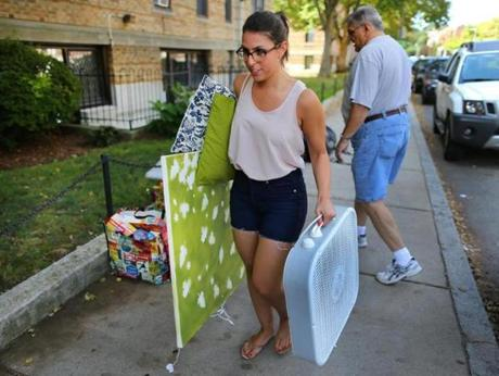 Ali Pappianne, a BU junior, gets help from her dad moving into an apartment on Buswell Street.