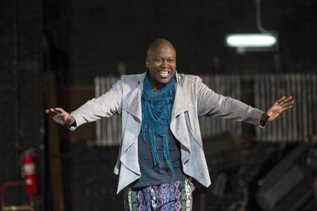 "In this image released by Netflix, Tituss Burgess appears in a scene from ""Unbreakable Kimmy Schmidt."" Burgess was nominated for an Emmy Award on Thursday, July 16, 2015, for outstanding supporting actor in a comedy series for his role on the show. The 67th Annual Primetime Emmy Awards will take place on Sept. 20, 2015. (Eric Liebowitz/Netflix via AP)"