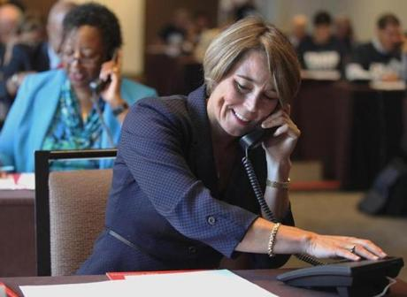 Healey made phone calls to seniors during the AARP Fraud Watch event in Boston.