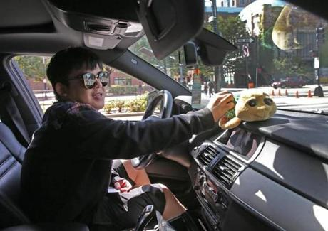 The Fantastic Rush Rally signal their club membership with a stuffed turtle on their dashboards. Pictured: Chris Shao, a BU student from China, in his BMW.