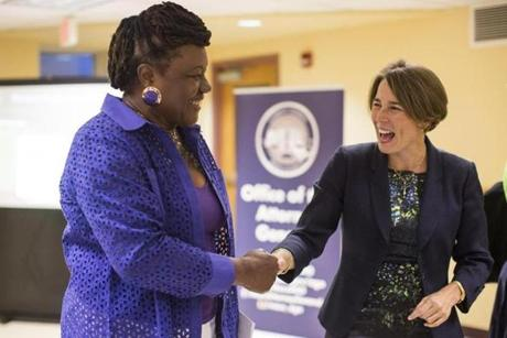 Healey spoke to Dorchester resident Gertrude Delsoin during a community outreach hour.