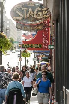 With live country  blasting through every bar door and window, Broadway in downtown Nashville is the top attraction for tourists.