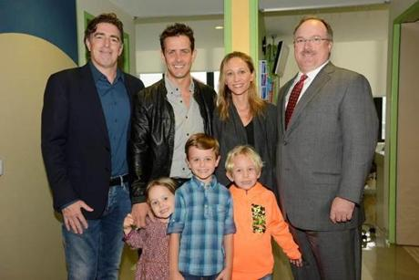 Earlier in the day, the McIntyres  — Joey, wife Barrett, and their kids Kira, Griffin, and Rhys — were with Mass. Eye and Ear board chairman Wyc Grousbeck (left) and CEO John Fernandez (right) at Mass. Eye and Ear.