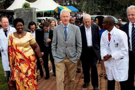 Bill Clinton walked toward the hospital in the Northern Province of Rwanda in 2012.