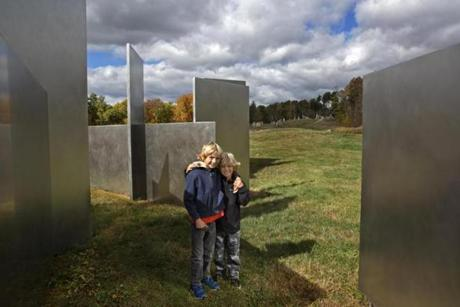 Brothers Magnus, 8, and Thor Manley, 6, of Ridgefield, Conn., at the stainless steel artwork, Escaping Flatland.