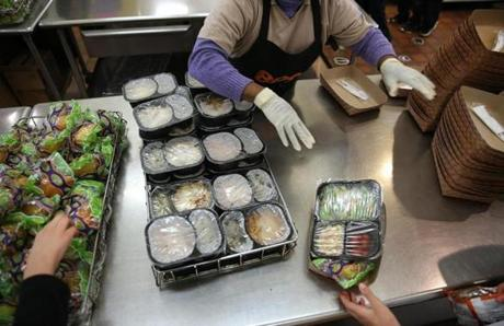 Boston, MA--10/21/2015--Students move through the line to collect lunch. School lunches, that were prepared in New York and trucked to Boston, are heated and served at the Blackstone Elementary School/Blackstone Innovation School, on Wednesday, October 21, 2015. Without a true cooking kitchen/cafeteria, the school's lunch area is called a satellite. Photo by Pat Greenhouse/Globe Staff Topic: schoolfood Reporter: James Vaznis