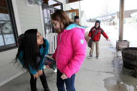 Tanisha Gannett,13, and Ashlynn Rubio, 10, adopted children from different families, connected after school at the Treehouse community center.