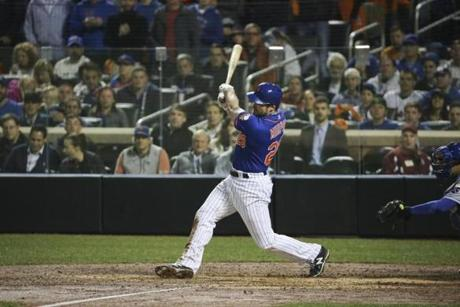 New York Mets second baseman Daniel Murphy at bat in the sixth inning of Game 5 of the World Series against the Kansas City Royals at Citi Field in New York, Nov. 1, 2015. (Richard Perry/The New York Times)