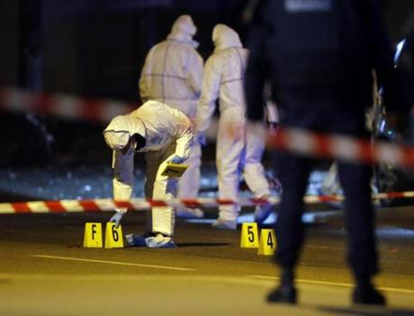 Investigating police officers worked on the crime scene outside the Stade de France.