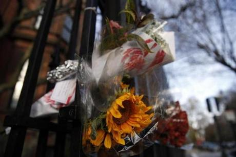 Flowers were tucked into the fence outside of the French Cultural Center on Marlborough St.