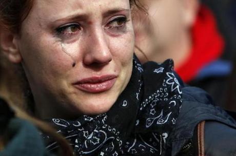 Marine Gazan, an au pair from France, cried during the Boston Common rally.