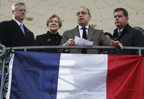 Gov. Charlie Baker, Mayor Martin Walsh, and Sen. Elizabeth Warren listened as Consulate General Valery Freland (center) addressed the crowd at the Boston Common.